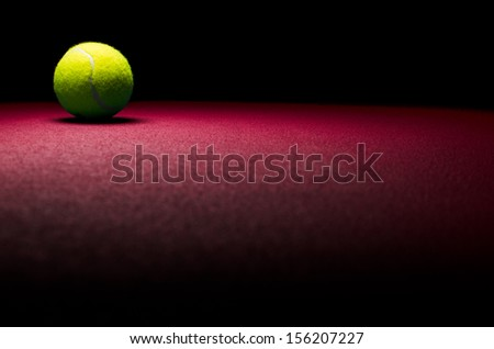 Tennis background - low key ball in corner with red surface