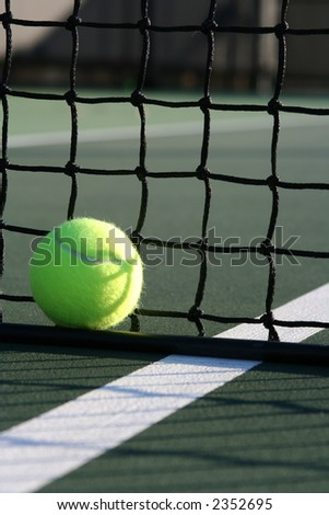 Tennis ball against the net verticle shot