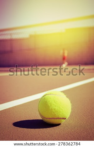 tennis ball and player with copy space - stock photo