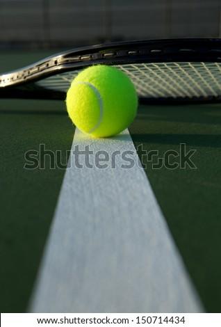 Tennis Ball and Racket Close Up - stock photo