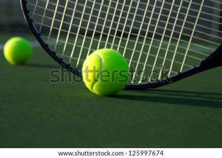 Tennis Ball and Racket Close Up with room for copy