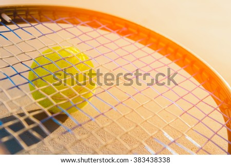 Tennis Ball and Racket. green color tennis ball on a tennis court. - stock photo