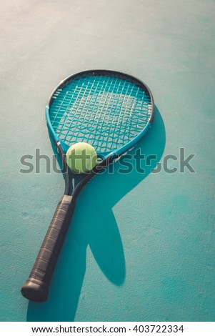 Tennis Ball and Racket. green color tennis ball on a tennis court - stock photo