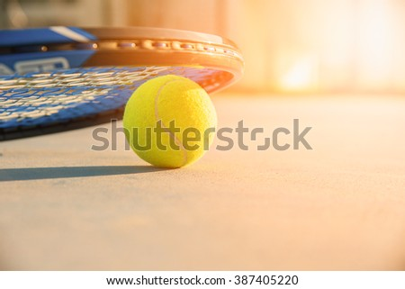 Tennis Ball and Racket. green color tennis ball. tennis ball from Thailand vivid tone. Tennis ball on a tennis court - stock photo