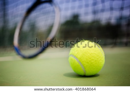 Tennis ball and Racket on tennis court - stock photo