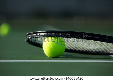 Tennis Ball and Racket on the Court with room for copy - stock photo