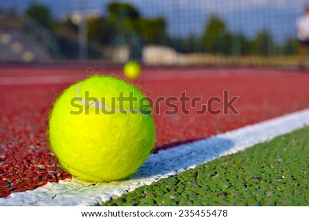 Tennis ball close-up with Net in the background  - stock photo