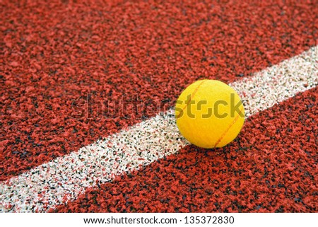 Tennis ball hitting the line for a point. - stock photo