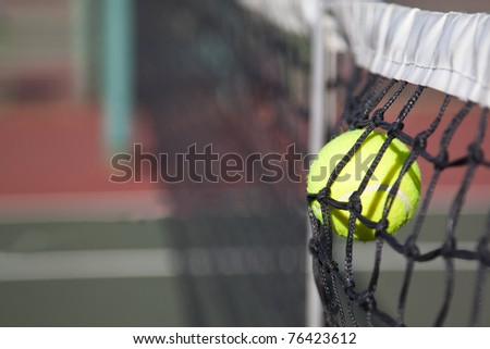 Tennis ball hitting the net on a court point lost