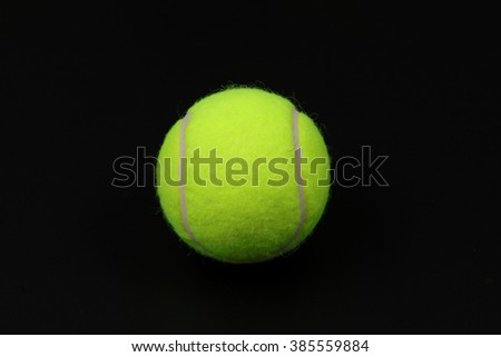 Tennis ball in black background
