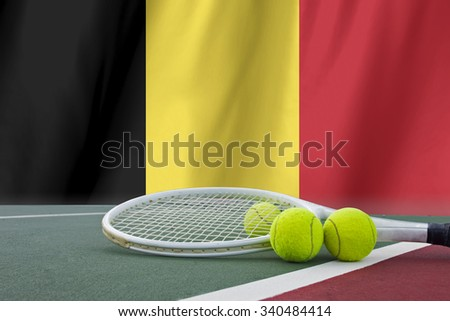 Tennis ball in net on Belgium flag background.