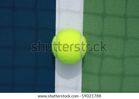 tennis ball in the middle of the boundary line