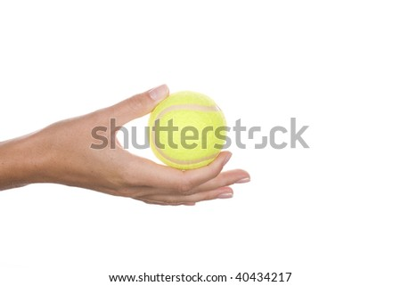 tennis ball in the woman hand