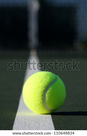 Tennis Ball Isolated on the Court - stock photo