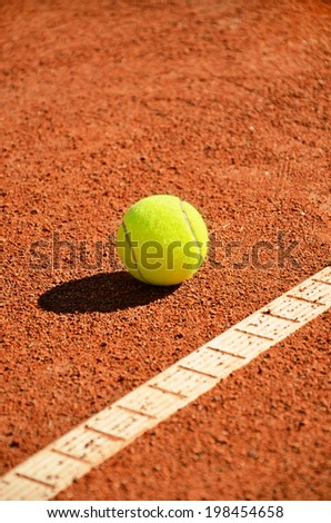 tennis ball near markup. diagonal vertical format - stock photo