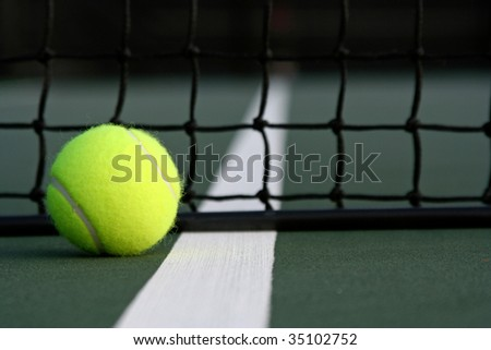 Tennis ball near the net