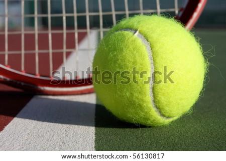 Tennis Ball near the Racket - stock photo