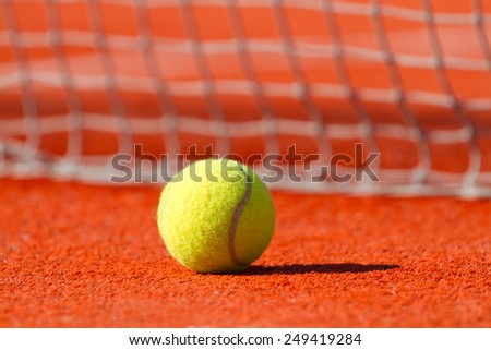 Tennis ball on a hard court  - stock photo