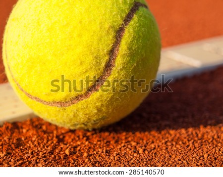 Tennis ball on court,close up - stock photo