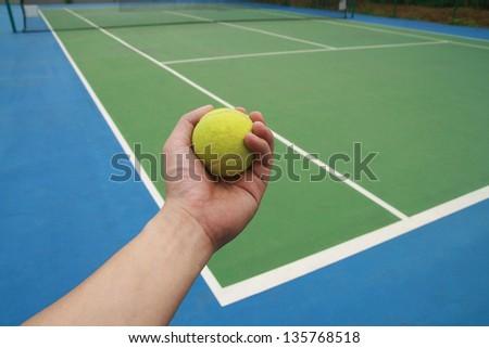 tennis ball on  player hand - stock photo