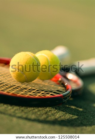 tennis ball on racket - stock photo