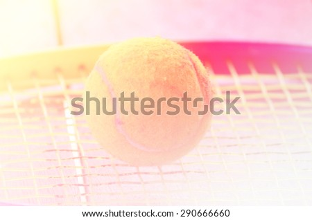 tennis ball on racket Shallow Dof. - stock photo