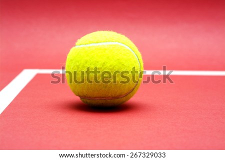 Tennis ball on red background.