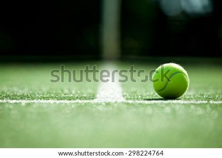 tennis ball on tennis grass court - stock photo