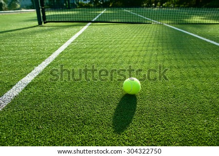 tennis ball on tennis grass court good for background - stock photo