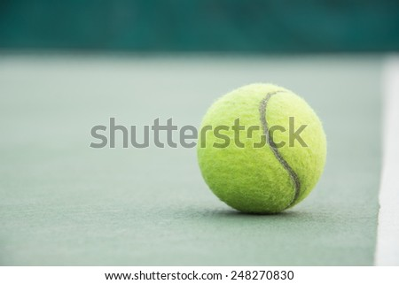 tennis ball on the court - stock photo