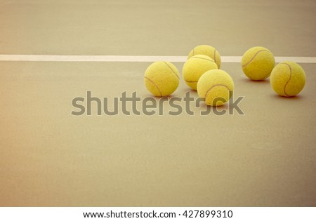 Tennis Ball on the Court Close up, vintage - stock photo