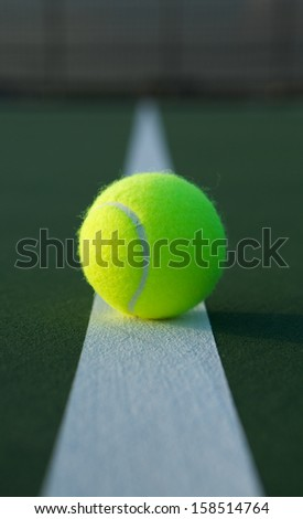 Tennis Ball on the Court Line Close up - stock photo