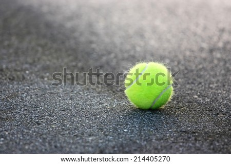 Tennis ball on the ground - stock photo