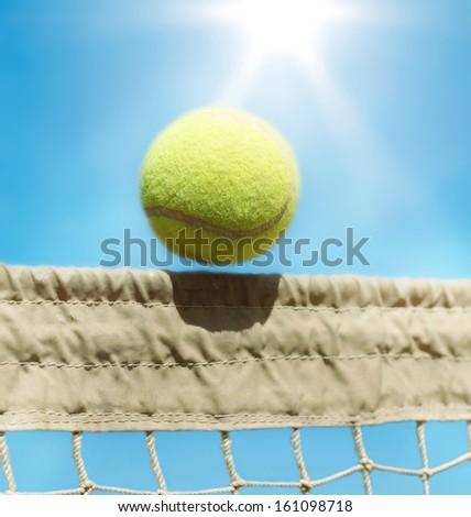 Tennis ball over a net.  - stock photo
