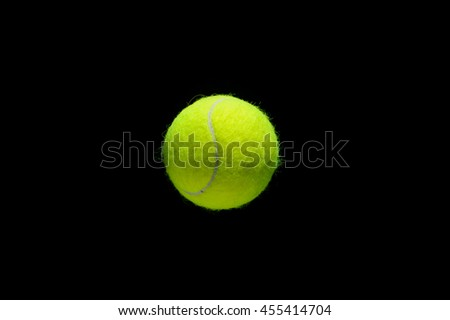 tennis ball over black background