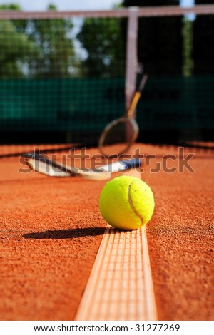 tennis ball, racket and net