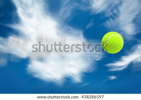 Tennis ball with a syringe against blue sky with clouds