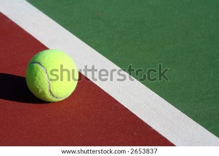 Tennis ball with diagonal line - stock photo