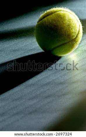 Tennis ball with racket shadows - stock photo