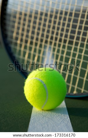 Tennis Ball with Racket Strings in the background - stock photo