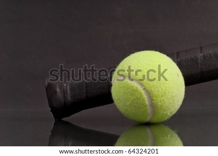 Tennis Ball with Tennis Racket Handle with Reflection - stock photo