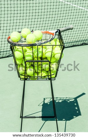 Tennis balls and racket - stock photo