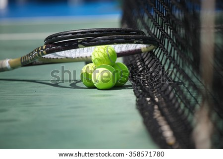 Tennis balls and racquets on the court close-up - stock photo