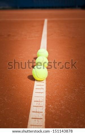 tennis balls in line - stock photo