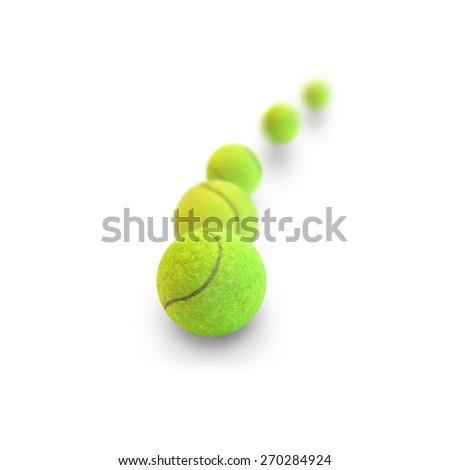 Tennis balls in motion on a white background - stock photo