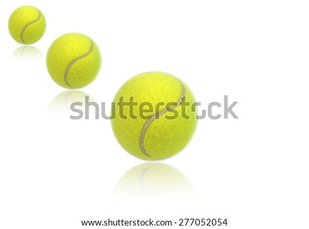Tennis balls isolated on white background with reflections. - stock photo