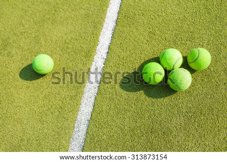 tennis balls lying on the court