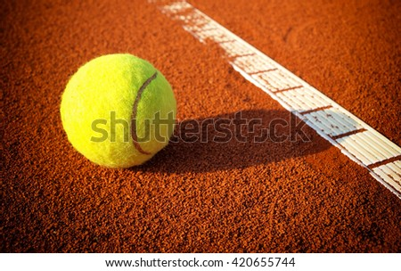 Tennis balls on a tennis clay court