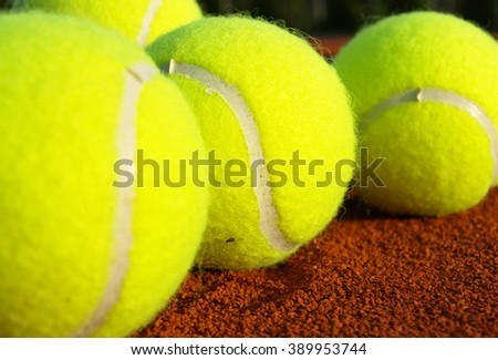Tennis balls on court,close up - stock photo
