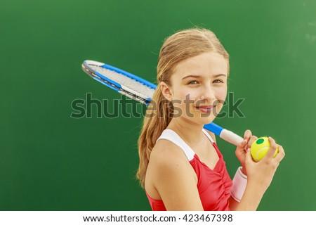 Tennis - beautiful young girl tennis player - stock photo